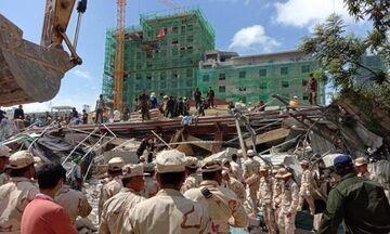 Eπτά νεκροί, τριάντα αγνοούμενοι από κατάρρευση κτιρίου στην Καμπότζη (vid+pics)