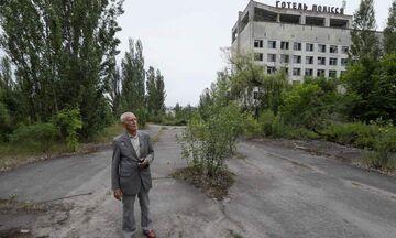 Στο Τσέρνομπιλ ξανά ο ήρωας πιλότος που πέταξε πάνω από τον αντιδραστήρα